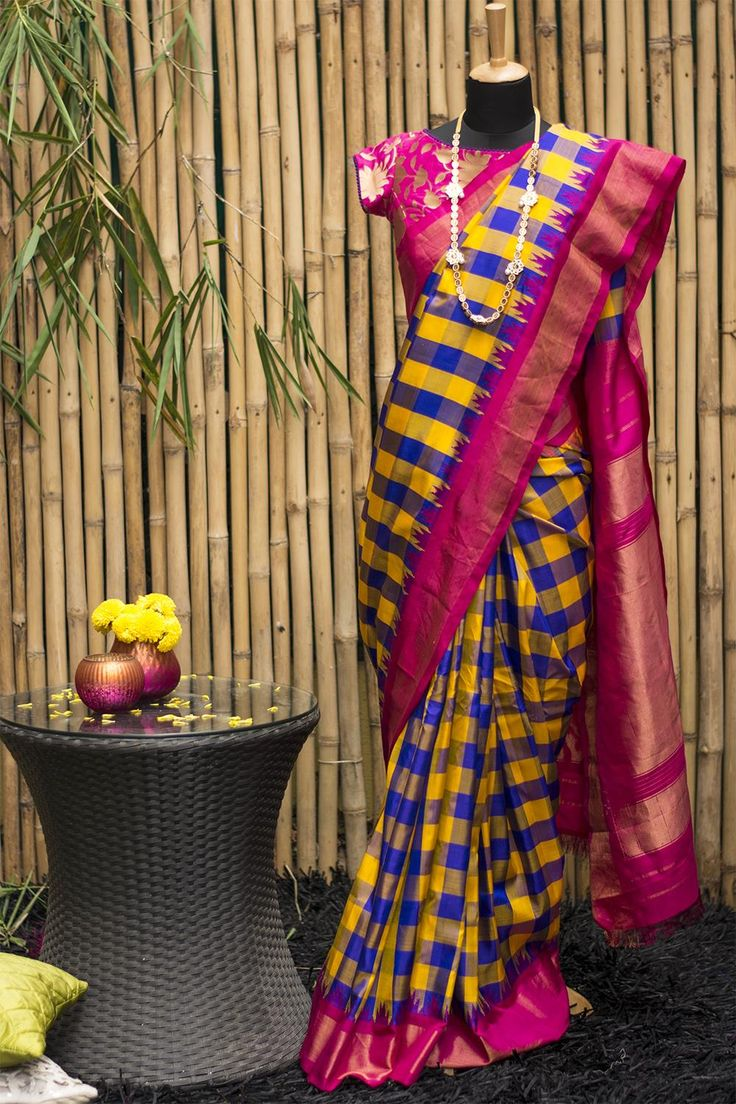 Drumroll for another of our hot favourites this festive season! This creative combination of patterns and colors in Gadhwal pure silk just sizzles…Bold yellow blue checks allover with a striking pink gold border and traditional temple motifs, the Gadhwal weavers never seize to amaze us with their creativity. And oh…that pallu in pink gold! #houseofblouse #festive #saree #puresilk #blouse #indianwear #india #fashion #bollywood #checks