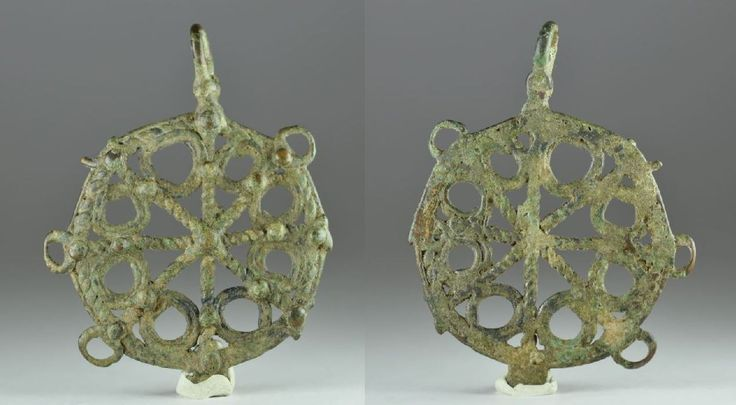 Luristan Amlash bronze coiled wire  openworked pendant , 1st millenium B.C. 8 cm high. Private collection