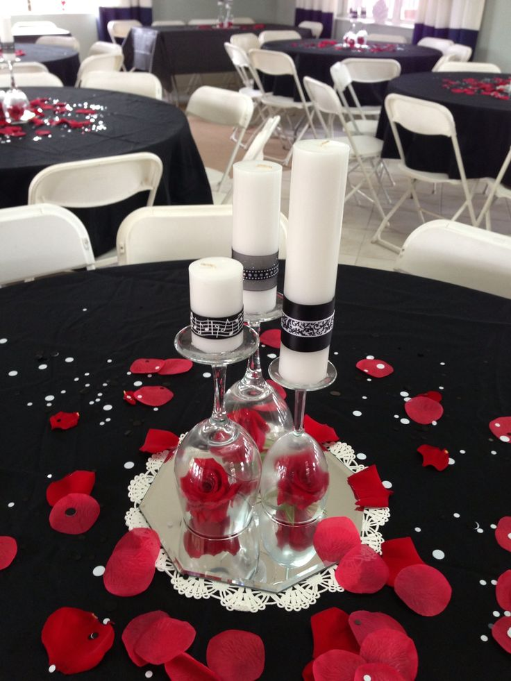 Centerpieces I made using candles, wine glasses and roses