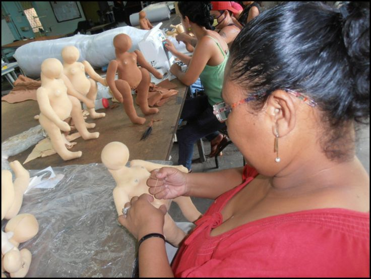 Dona Tomasa working on a MamAmor doll