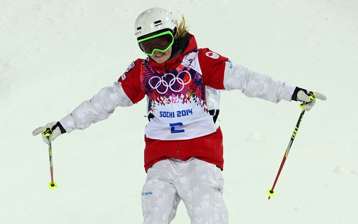 Canada's Justine Dufour-Lapointe celebrates during the Women's Freestyle Skiing Moguls finals at the Rosa Khutor Extreme Park during the Sochi Winter Olympics on February 8, 2014. AFP PHOTO / JAVIER SORIANO (Photo credit should read JAVIER SORIANO/AFP/Getty Images)