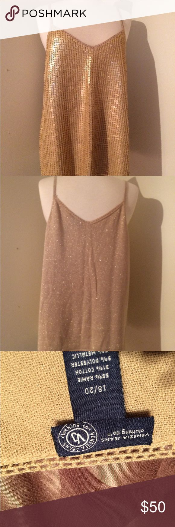 """Sequined Gold Blouse NWOT This is a stunning spaghetti strap top that glistens front and back. From elegant wear to casual, this sequined top is perfect for all occasions. It is an """"OMG"""" beautiful top. Some sequins may flip up, simply swipe hand downward all good. No snags or loose sequins. Camisole style top. Size is an 18/20 Venezia Jean Clothing co. Tops Camisoles"""