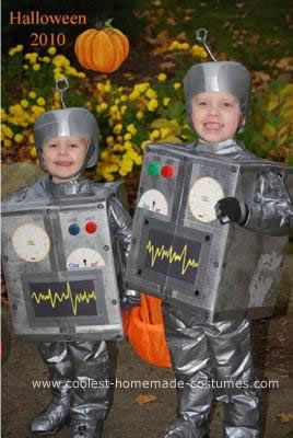 Homemade Bro-Bots Halloween Costumes: I made my sons, ages 2 and 4 each a robot costume out of cardboard boxes, duct-taped together and spray-painted silver...