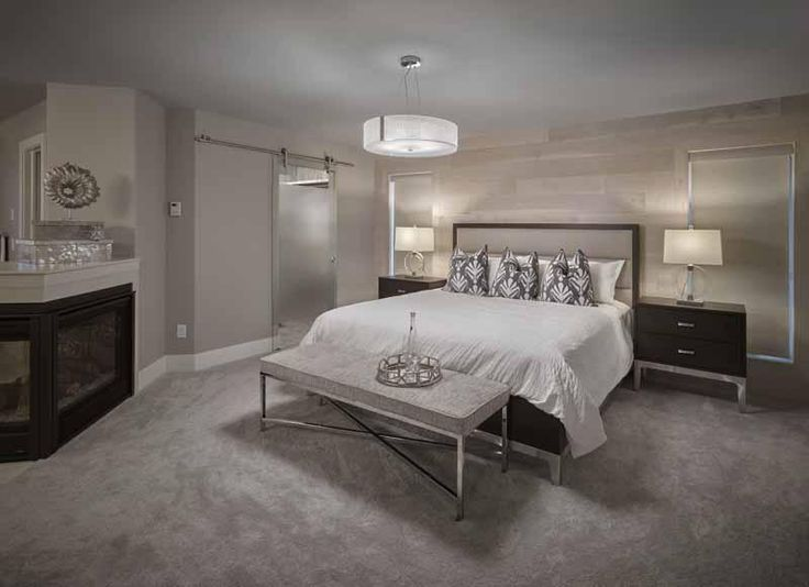 Master Bedroom. Glass barn doors. New Hampshire model by Kimberley Homes in Jensen Lakes #interiordesign #newhomedesign #homedesign #newhome #customhome #yegre #buildwithkimberley #kimberleyhomes #bedroominspo #bedroomideas #bedroom #masterbedroom