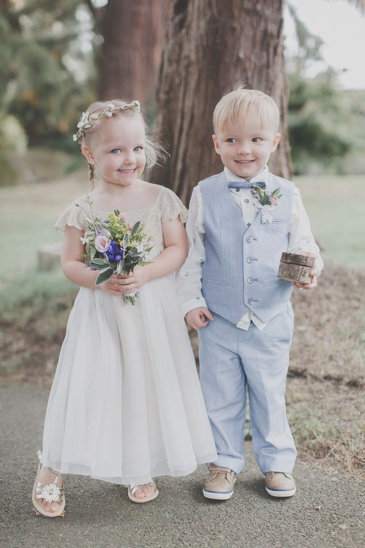Flower Girl in Monsoon Dress & Page Boy in Pale Blue Trousers, Waistcoat & Bow Tie - Ferri Photography | Lace Sincerity Bridal Wedding Dress | Folky Dokey Flower Crown | Country Wedding at The Althorp Coaching Inn | Rustic Lace, Hessian, Tree Stump DIY Decor