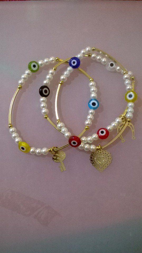 fin de semana (pulseras) de perlitas y ojo turco