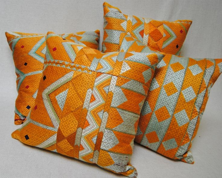 Custom pillows cut from vintage Phulkari Bagh wedding shawls from Punjab, India.  Silk embroidery on hand loomed khadi cloth.  Maison Suzanne Gallery