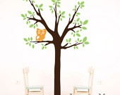 Exactly how I want to do the playroom..tree with chairs on each side and a small bookcase in between and hang the kids names with ribbon on the branches :)
