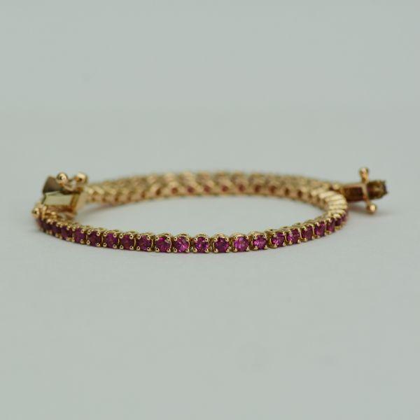 Bratara din aur roz cu rubine rotunde