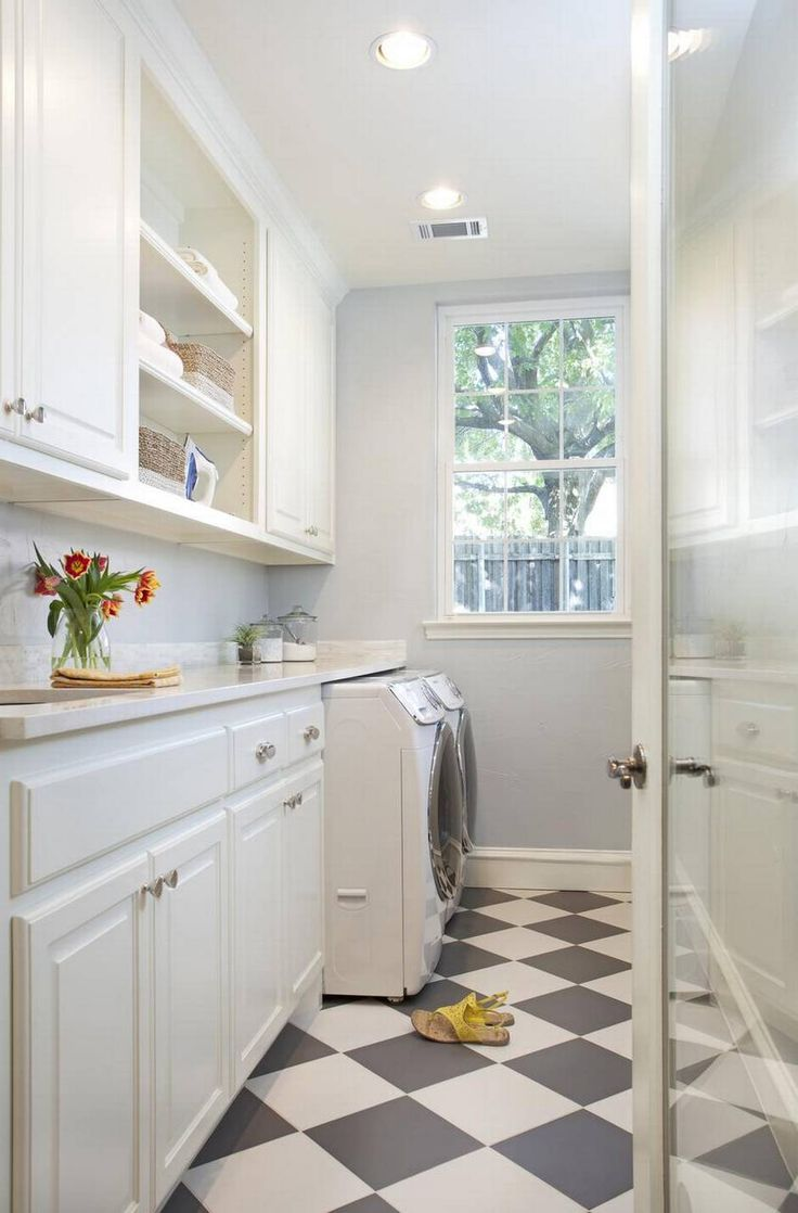 Narrow Laundry Room in White.  Love that checkerboard floor. It adds so much character! Visit LaundryShoppe.com for more Laundry Decor.
