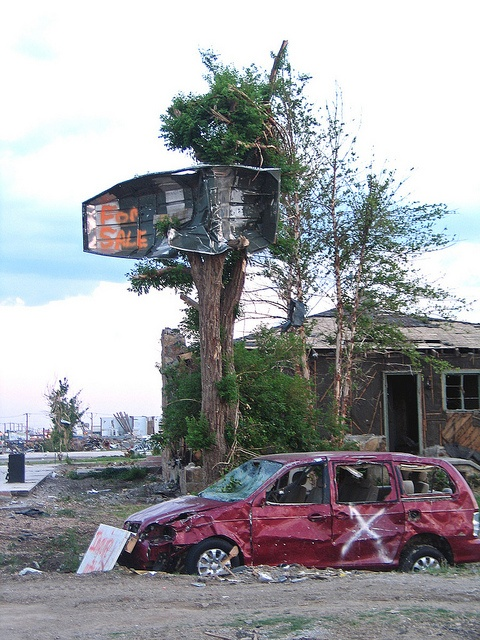 boat in tree in Joplin, Missouri, the tornado bought the community so close together.
