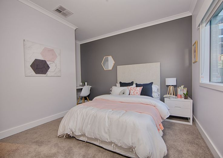 Statement art, a study area and hints of pink make this the perfect bedroom for a teenage girl.