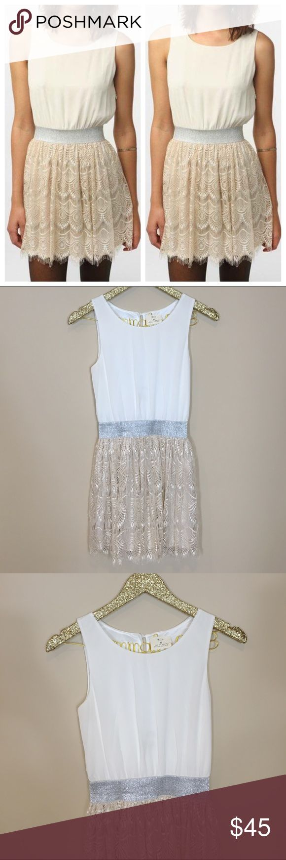Urban Outfitters Lurex and Lace Dress NWOT - tags removed but never worn! Urban Outfitters Lurex and Lace Dress from Pins and Needles. So adorable! Sleeveless dress - white top with champagne Lace bottom skirt joined together by a flattering silver band at the waist. Size XS. No modeling/trades. Urban Outfitters Dresses