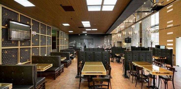 Специально для кафе были спроектированы и реализованы уникальные конструкции и мебель: каменный мобильный бар и столы.
