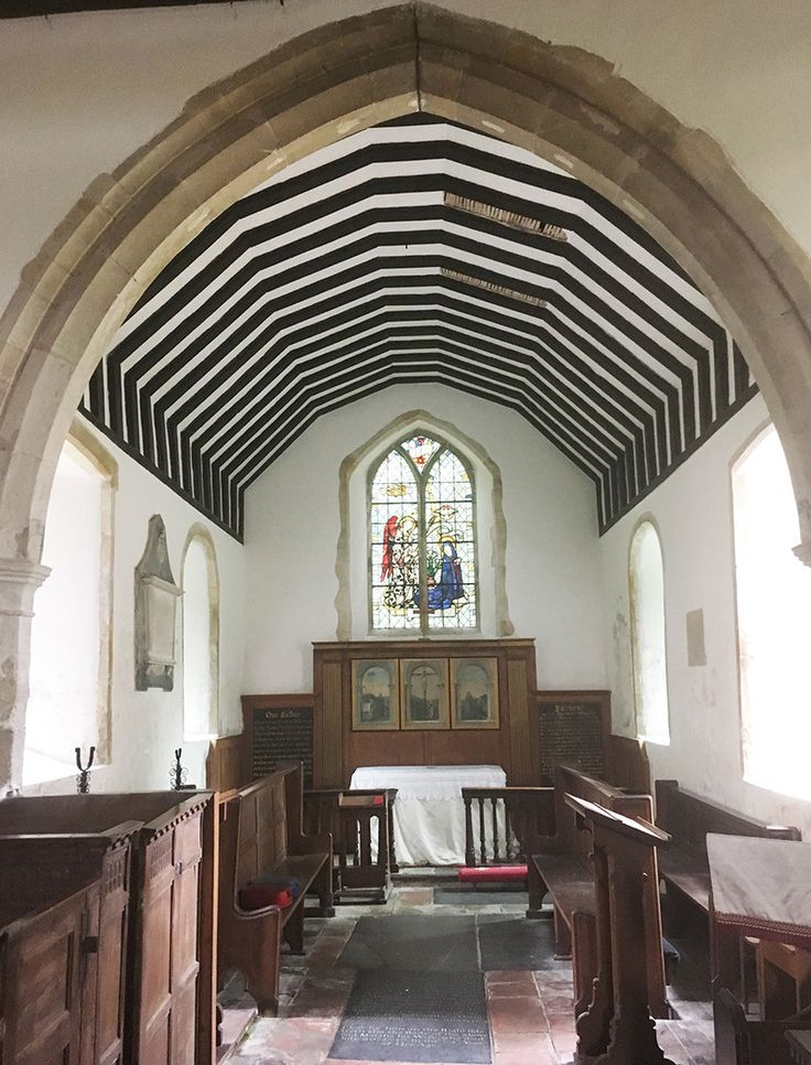 """In England, You Can Camp in Abandoned Medieval Churches """"Champing"""" supports the upkeep of village churches, while offering travelers a unique overnight stay. Chancel arch, with stain glass of royal arms of James II."""