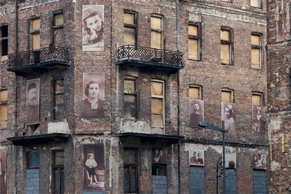 Holocaust remembrance advocates plastered images of Polish Jews on buildings in Warsaw that were part of the Jewish ghetto before World War II wiped them out.