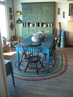 American Country Antiques - love the colors.    Anyone have a cabinet like that they'd like to sell??