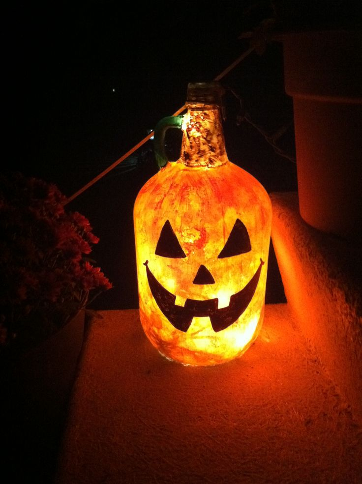 Wine jug turned Halloween decor, just paint and add Xmas lights