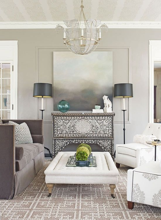living room - gray and white - love the printed chair, soft gray couch, inlaid chest.  Colors of rug, lamps, picture.  note ceiling painted.