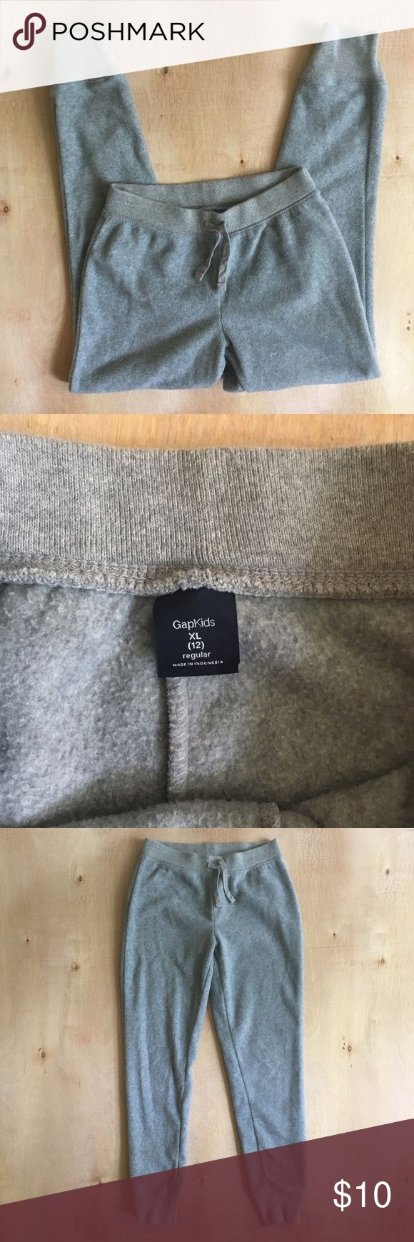Gap Kids Fleece Joggers Gap Kids girls' size XL (12) gray fleece jogger sweatpants in excellent used condition! Very soft. No external pilling. No stains or holes. Bundle for additional discount! GAP Bottoms Sweatpants & Joggers