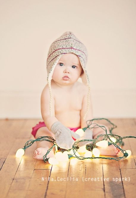I think that A Moment in Time Photography should do a Christmas shoot of my son! Laura, look at this!