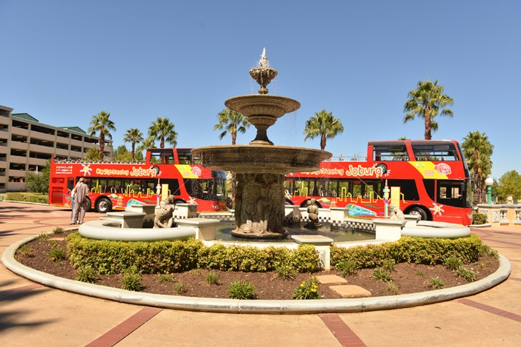 Two City Sightseeing buses wait ,at the second possible starting point, at Gold Reef City.