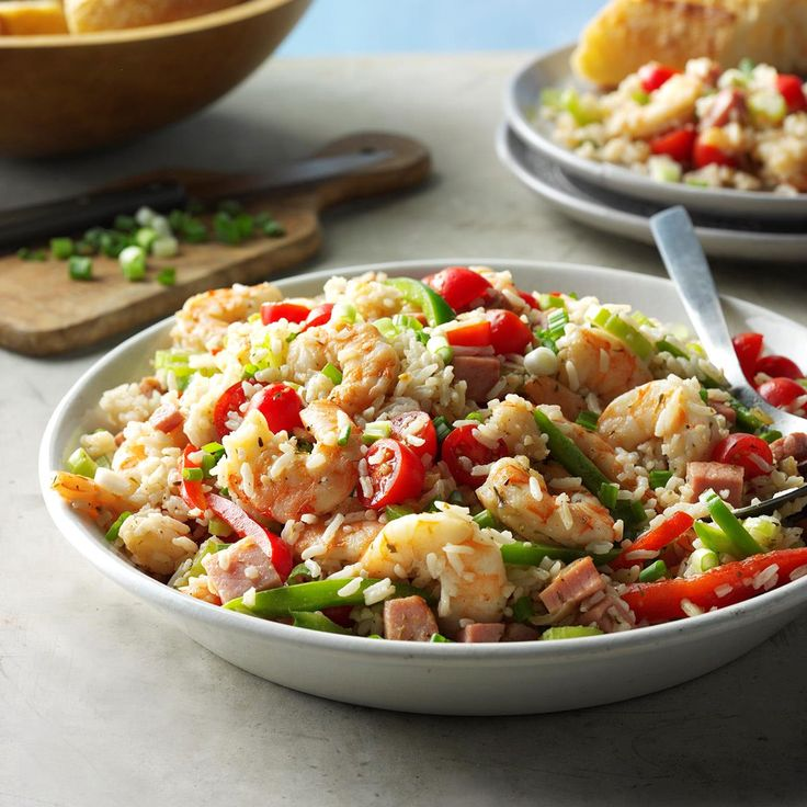 Jambalaya Rice Salad Recipe -This cold rice salad has a little hint of spice for that classic Jambalaya kick. Shrimp, tomatoes, ham and peppers give it color and crunch. —Karen Rahn, Hixon, Tennessee