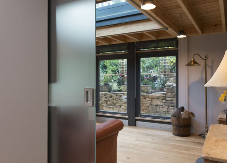 Contemporary Extension Bath, Hidden Glazed Sliding 					Door Timber and Glass Sun Room