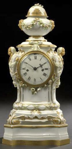 Justin Vulliamy (1712 to 1797) London ~ White and gold ~ Royal Berlin (KPM) porcelain mantel clock ~ Louis XVI taste ~ Presented on a conforming gilt-brass-edged platform base ~ With a two-train fusee movement ~ Origin england ~ Circa 1850-1875