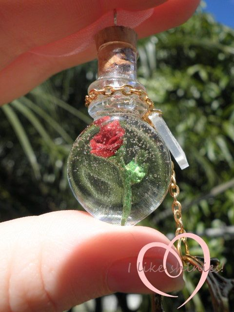 A teeny rose suspended in resin inside a bottle! What an idea! So many things you do like this as gifts! I would like to get bottles like this to put beach sand and small sea shells in to send as gifts. Hang them on your Christmas Trees.