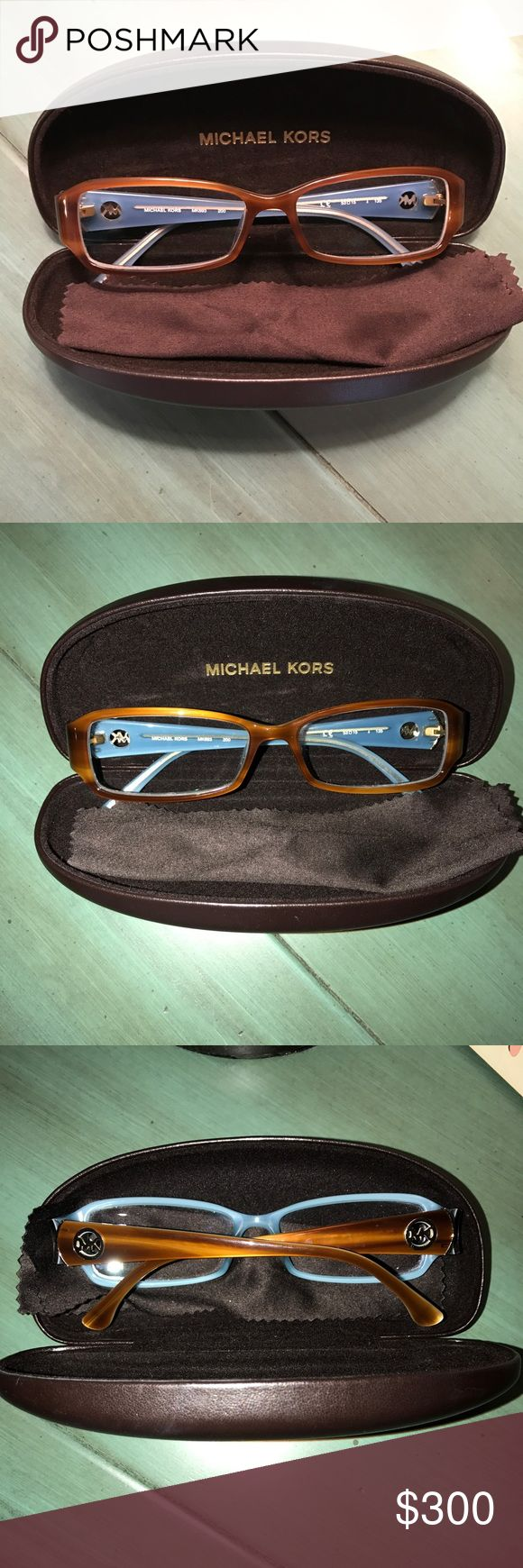 RARE Michael Kors prescription glasses Rare Michael Kors glasses not sold anymore, color is true to pictures, very light blue inside that can't be seen when wearing glasses and light wood colored wood frames. Frames were $350 and prescription was $95. They are -2.00 prescription glasses with anti-glare upgrade. The lenses are crystal clear not scratched or anything as well as the frames. I bought these as my back up pair and ending up loving my first pair more so I've only worn these twice…
