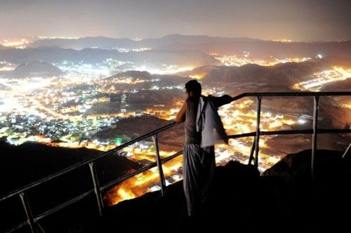 A Muslim pilgrim looks at Mecca from the top of Noor mountain