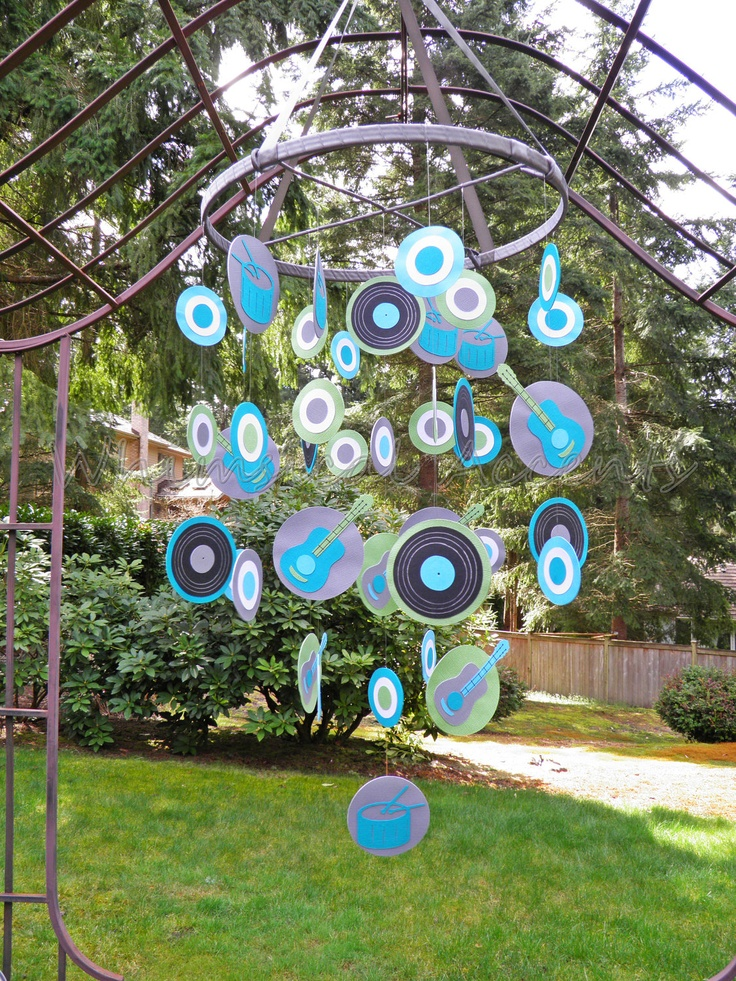Use teal & grey scrapbooking paper...maybe use as a flat backdrop instead of a circle