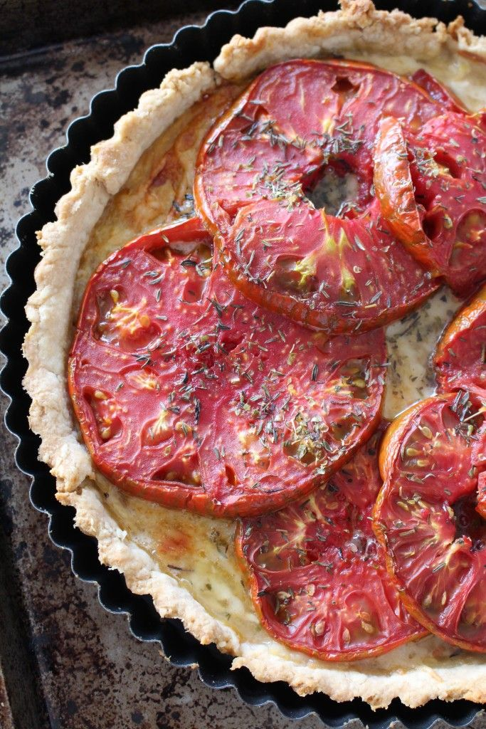 A traditional French tomato tart doesn't use custard; instead you simply brush pastry with mustard, add a thin layer of grated cheese, and another of sliced tomatoes, before baking in a blistering oven.