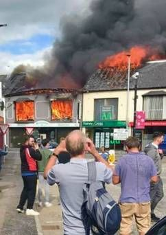 #Asbestos found at site of fire that swept through Northern Ireland shops