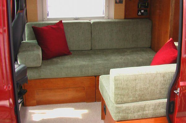 I love this bed design for the camper.  Could use a real mattress and make it actually be comfortable to sleep!