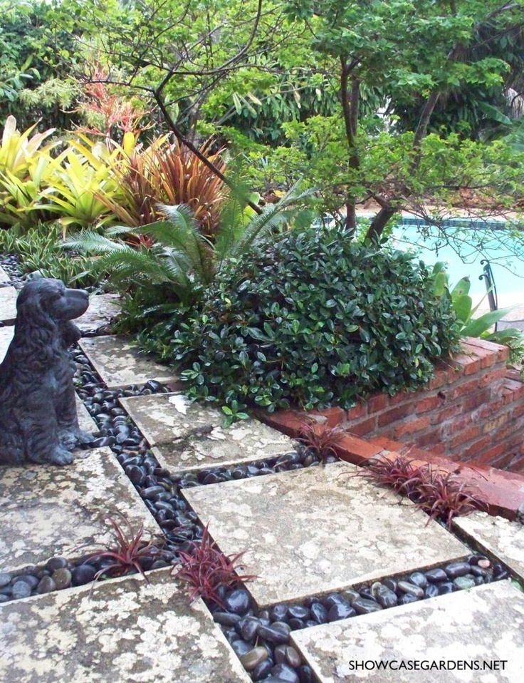 love the mix of pavers, stone and brick.  poolscape_in_ft.lauderdale