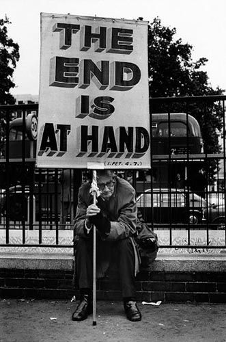 """Elliott Erwitt, """"London, England, 1978."""" Evidently, The End has been delayed.  Probably for about a billion or more years, so not to worry."""