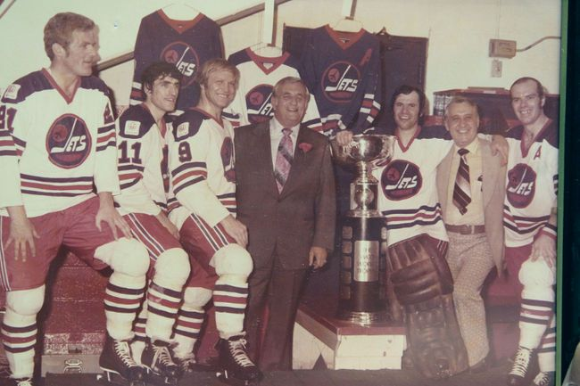 Hatskin (centre) and Hull (immediate left) with Jets players after winning the championship. (Courtesy, Joe Daley's collection)