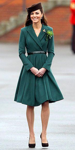 Kate Middleton in emerald wrap coat and brown pillbox hat celebrating St. Patrick's Day in Aldershot, England