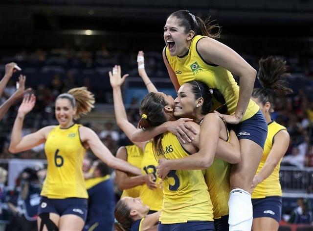 Brazil's Natalia Pereira (top R) celebrates with her team mates Jaqueline...