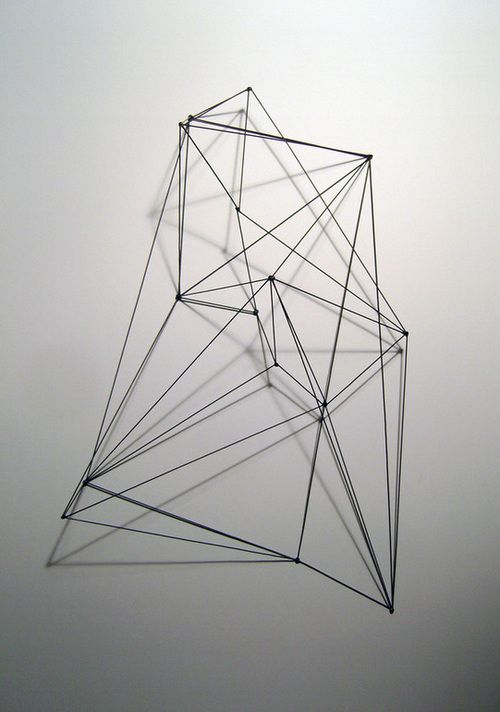 Metal sculpture by Andrew K Green. The geometric shapes in this piece inspired me to do mine