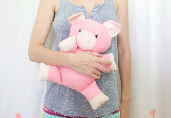 This little piggy is looking for a new home. He is made out of pink wool blend felt and filled with polyester stuffing. He measures around 13