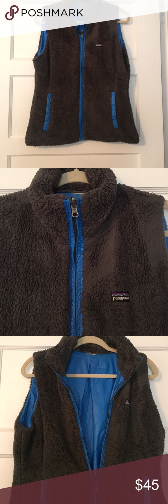Patagonia Charcoal gray and blue vest Great condition Patagonia vest. Worn only a few times. So soft. Pockets ! Patagonia Jackets & Coats Vests