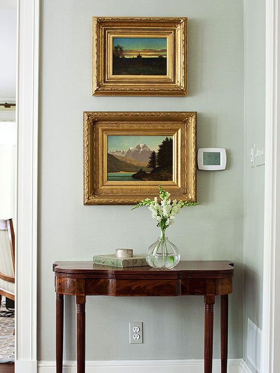 I love this classic art arrangement with the small frame on top & larger frame below