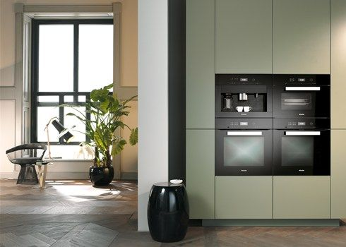 Built-in ContourLine appliances with easy-care CleanSteel stainless steel surfaces and traditional rotary knob operation from Miele