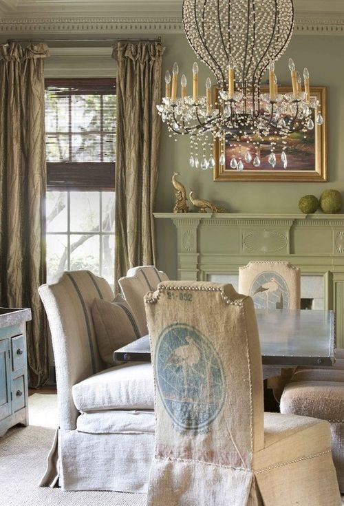 Shabby Chic Dining Room Decorated With A Vintage Chandelier U0026 Burlap  Covered Chairs.
