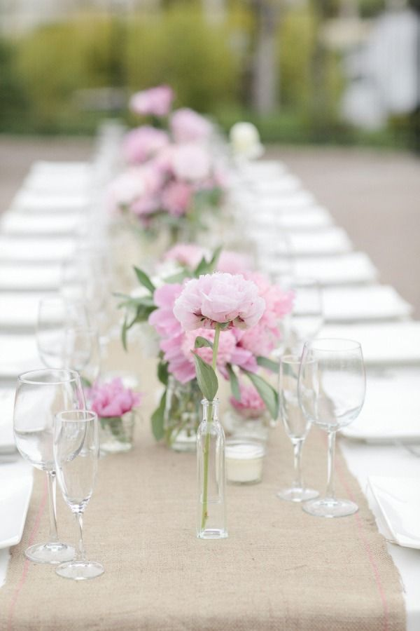 Simple wedding decor. White linen, burlap runner, lots of small glass vases and candles. Adore.