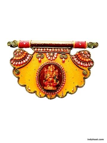 A very exclusive wooden key stand decorated with paper mache and lord ganesh idol in the center in traditional pankhi design. Decorate your walls with this beautiful best quality handmade artifact.   - See more at: http://indyhaat.com/Wall-Decor/Key-holder-with-Ganesh-Ji-id-295496.html