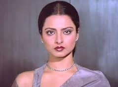 rekha-i believe this is the hospital guldasta scene from Silsila.  Those eyes. uff.
